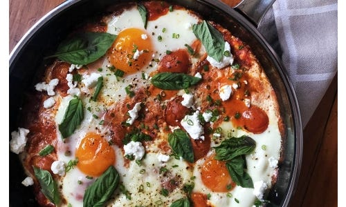Alexis deBoschnek's Baked Eggs in Spiced Tomato Sauce with Goat Cheese